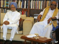 Indian PM Manmohan Singh (left) and DMK leader M Karunanidhi