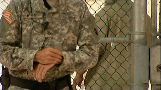 Guard at Guantanamo checks his watch