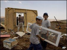 Israeli settlers try to rebuild a demolished building in the West Bank