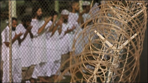 Guantanamo Bay detainees praying before dawn