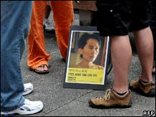 Protesters from Amnesty International stand around a portrait of Aung San Suu Kyi in Hong Kong on May 21, 2009.