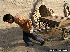 A brick factory in China, which employs paid workers (file photo)