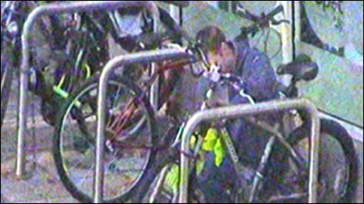 Police CCTV image of a man stealing a bike in central Bristol