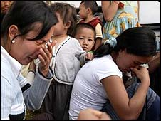 Hmong women crying after being told by the thai authoirities that they will be sent back to Laos