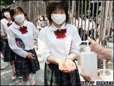 Pupils in Tokyo, Japan disinfecting their hands