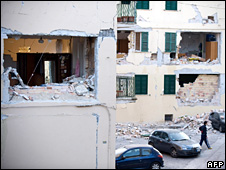 Man walks past ruined blocks of flats in L'Aquila (file)