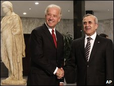 Joe Biden shakes hands with President Michel Suleiman