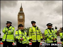 Police officers stand guard in front of the Houses of Parliament