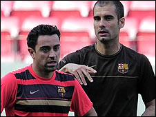 Xavi (left) and Barca coach Pep Guardiola