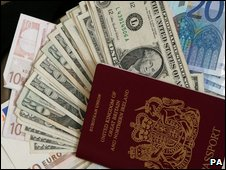 A passport and foreign currency
