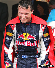 David Coulthard celebrates Red Bull's first ever podium in Monaco in 2006