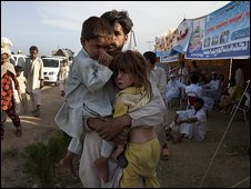 Displaced arrive at the relief camp in Mardan
