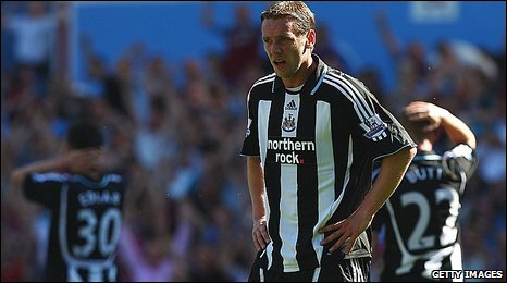 Kevin Nolan looks inconsolable