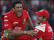 Bangalore captain Anil Kumble celebrates a wicket with keeper Mark Boucher