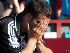 Defender Steven Taylor reacts after Newcastle's relegation