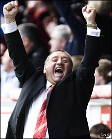 Jimmy Calderwood celebrates beating Hibs