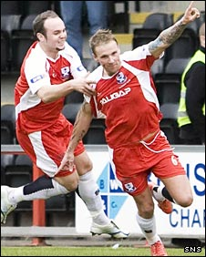 Ryan Stevenson (right) wheels away to celebrate his goal