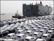 New VW cars wait to be loaded onto a ship