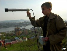 A Russian meteorologist uses a radiation monitoring set in the Pacific port of Vladivostok, 25 May