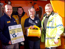 (Left to right) lifeboat mechanic Ian James, crew member Gareth Owen, coxswain Brian Thomson and Pc David Owen