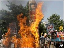 Mock North Korean missiles being burned