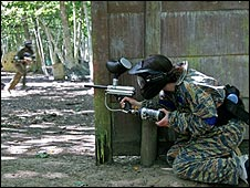 Paintballer takes cover, Campaign Paintball, Cobham, Surrey