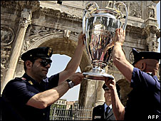 Italian police with Champions League trophy