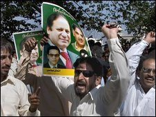 Supporters of opposition leader Nawaz Sharif celebrate after the Supreme Court decision in Islamabad, Pakistan on Tuesday, May 26, 2009