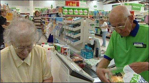 An elderly gentleman serves an elderly customer