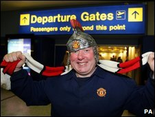 Manchester United fan Chris Nolan at Manchester Airport prior to flying out to Rome for the UEFA Champions League Final