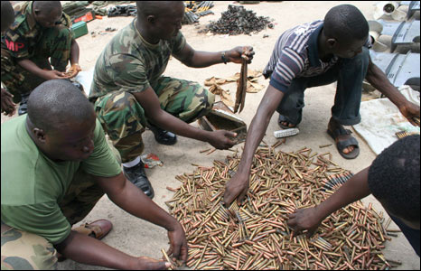 Nigerian soldiers count bullets