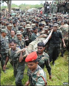 Sri Lanka soldiers carry the body of Prabhakaran