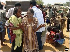 Sri Lankan ethnic Tamils react after shelling in Mullivaaykaal, Sri Lanka