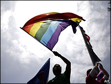 A gay marriage campaigner holds up a rainbow flag at a protest against the California Supreme Court's decision to uphold a ban on same-sex marriage in the state