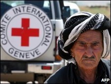 An Iraqi Kurdish man next to an ICRC vehicle on May 19