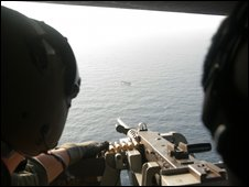 South Korean snipers on a helicopter aim at suspected pirates south of Aden port in Yemen