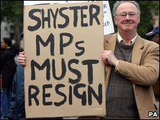 Man protests outside Parliament about MPs expenses