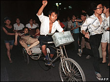 Two injured during the clash between the army and students 04 June 1989 near Tiananmen Square are carried out by a cart.  4 June 1989