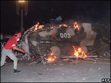 An armoured personnel carrier is in flames as students put in on fire 04 June 1998 near Tiananmen Square in Beijing.