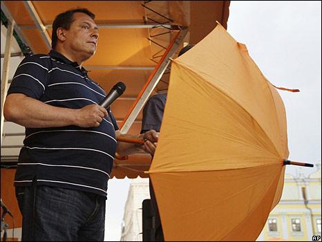 Czech opposition leader Jiri Paroubek with umbrella