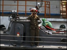 A North Korean soldier on a patrol boat on the Yalu River dividing China and N Korea, 27 May