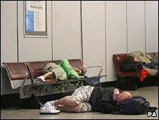 Manchester United fans asleep at Rome airport