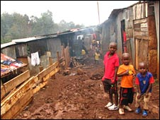 Three children in a shanty town outside Nairobi, Kenya (Image: Amnesty International)