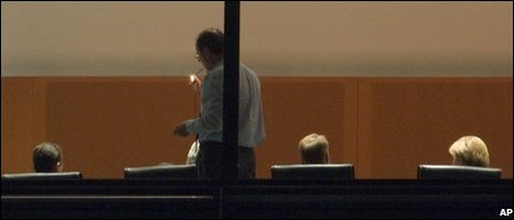 German Finance Minister Peer Steinbrueck, standing, lights his cigarette during the meeting