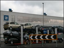 Cars being driven past the GM factory in Luton