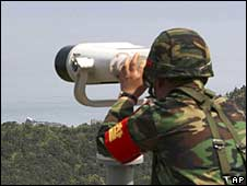 A South Korean marine soldier watches North Korean territory (8 May)
