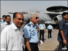 AK Antony walks in front of the Awacs plane