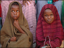 Two Somali girls wait for medical checks at a local health centre