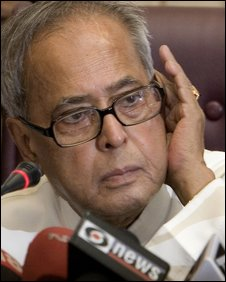 Indian Finance Minister Pranab Mukherjee listens to a question during a press conference in New Delhi, India, Wednesday, May 27, 2009