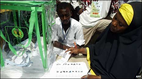 A woman voting in Nigeria